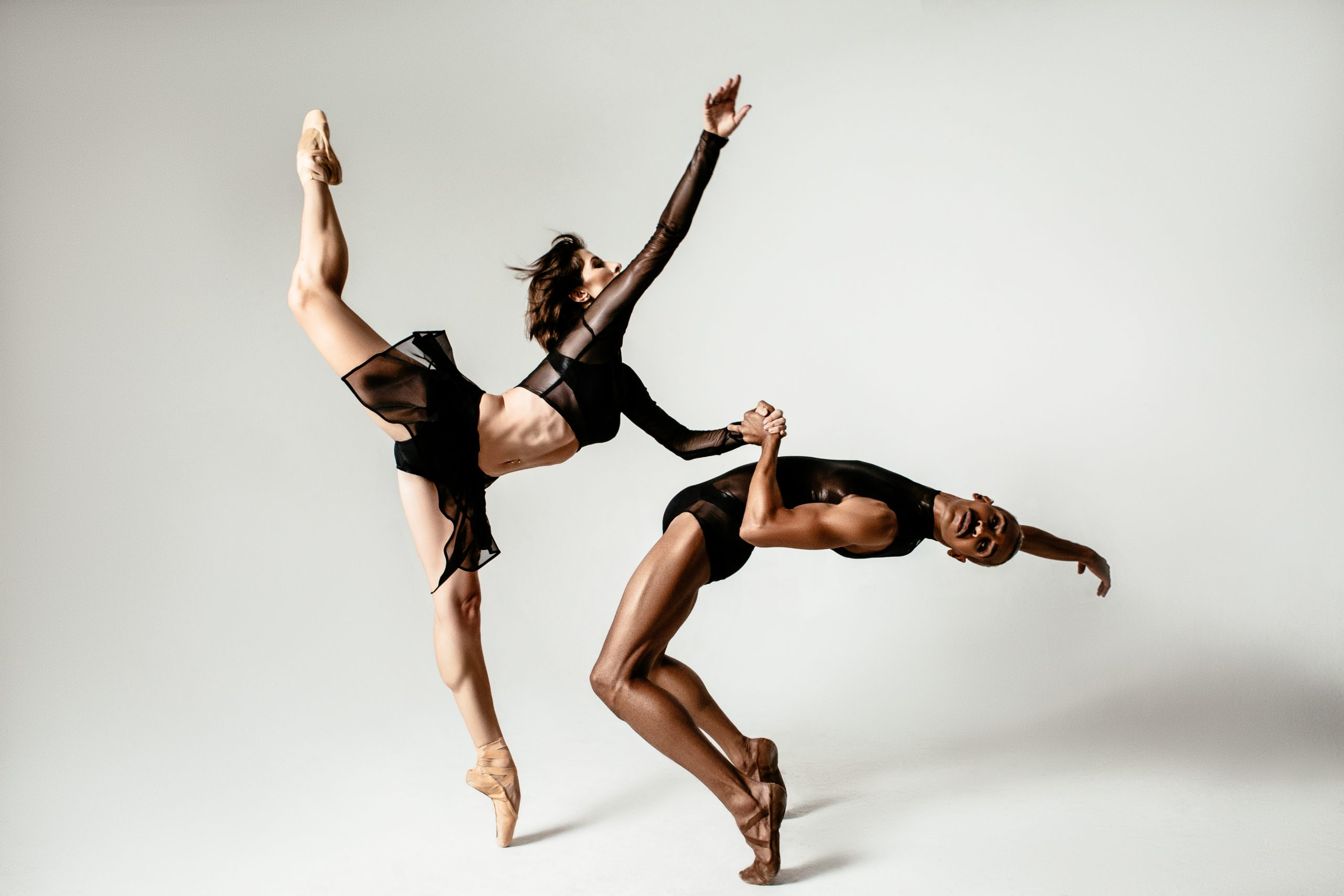 two professional dancers within the community